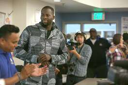 Warrior's Draymond Green (second from left) visits the science center at Oakland High School on Wednesday, October 12, 2016, in Oakland, Calif.
