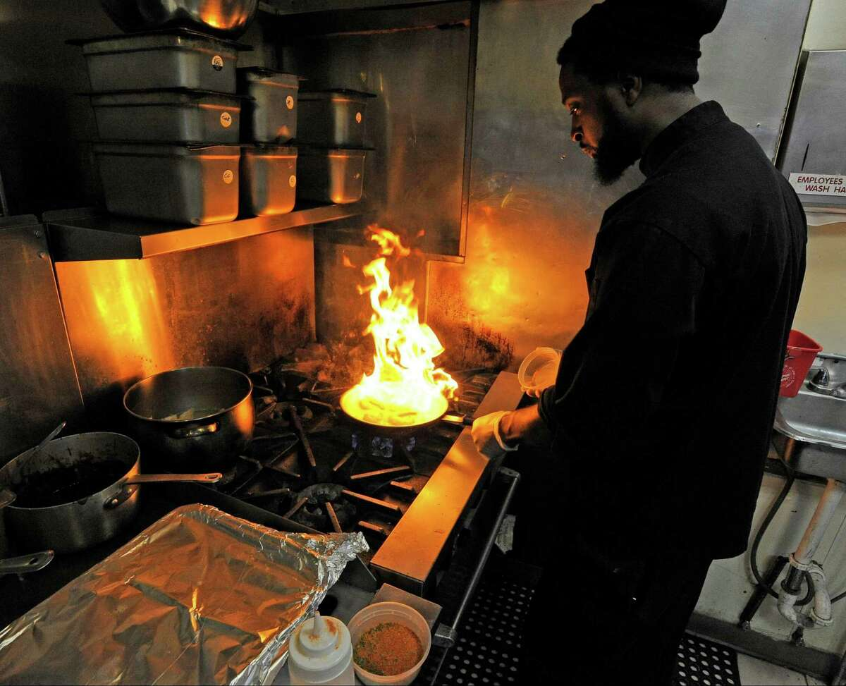Jean Gabriel, co-owner/chef of Soul Tasty, cooks Cajun Shrimp, one of the signature dishes for the new soul food restaurant in Stamford, Conn. on Tuesday, Oct. 11, 2016.