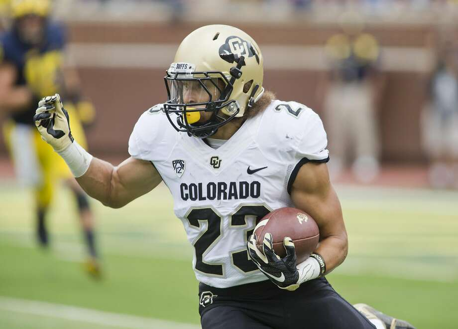 Colorado tailback Phillip Lindsay rushes for 4.9 yards per carry, has had a 100-yard receiving game and has scored seven touchdowns to help the Buffaloes aspire to Pac-12 title contention. Photo: Tony Ding, Associated Press