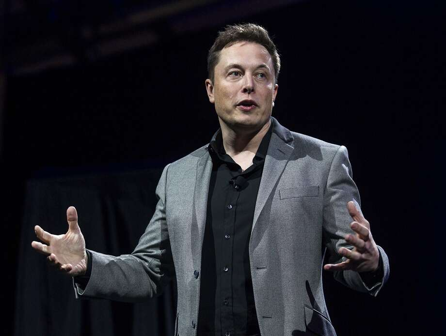 FILE - In this April 30, 2015, file photo, Tesla Motors CEO Elon Musk unveils the company's newest products, in Hawthorne, Calif. Tesla and SolarCity announced Wednesday, Oct. 12, 2016, that shareholders will vote on Nov. 17, 2016, on the proposed merger between electric car maker Tesla Motors and solar panel company SolarCity. Musk, who is also the chairman of SolarCity, proposed the merger in June 2016. (AP Photo/Ringo H.W. Chiu, File) Photo: Ringo H.W. Chiu, Associated Press