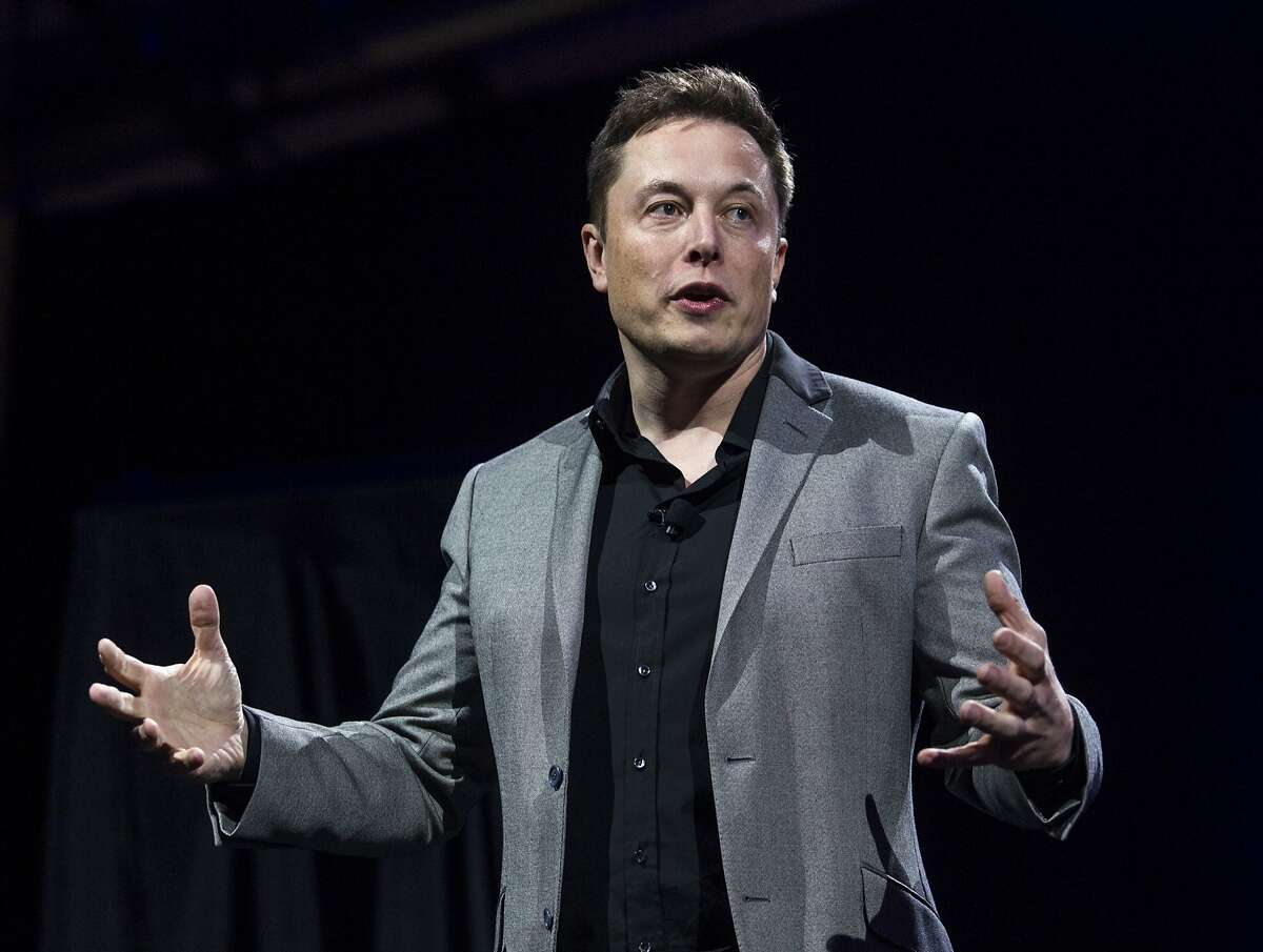 FILE - In this April 30, 2015, file photo, Tesla Motors CEO Elon Musk unveils the company's newest products, in Hawthorne, Calif. Tesla and SolarCity announced Wednesday, Oct. 12, 2016, that shareholders will vote on Nov. 17, 2016, on the proposed merger between electric car maker Tesla Motors and solar panel company SolarCity. Musk, who is also the chairman of SolarCity, proposed the merger in June 2016. (AP Photo/Ringo H.W. Chiu, File)