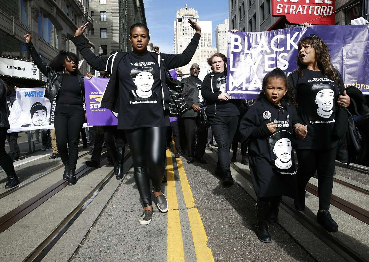 Yayne Abeba (left) leads protesters demanding justice for Mario Woods, the Bayview man shot and killed by police nearly two months ago, on a march down Powell Street before turning on Market Street to the site of Super Bowl City in San Francisco, Calif. on Saturday, Jan. 30, 2016.