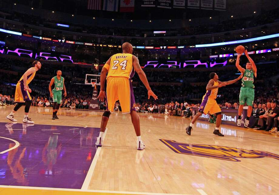 Staples High School Graduate John DiBartolomeo, right, takes a shot for Israeli club team Maccabi Haifa in preseason action against the Los Angeles Lakers on Sunday, October 10th, 2015. Lou Williams contests the shot while NBA players Kobe Bryant, center, and Ryan Kelly, left, look on. Photo: Seth Ribnick / Maccabi Haifa Basketball Club / Westport News Contributed