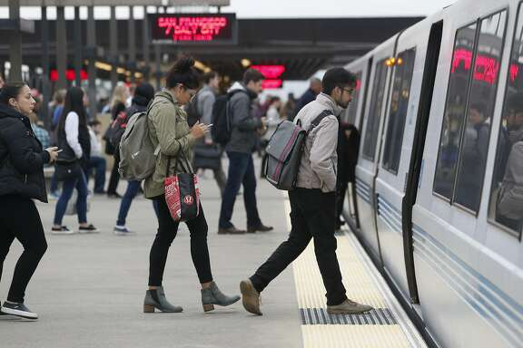Commuters board a San Francisco-bound train at the Rockridge BART station in Oakland, Calif. on Wednesday, Oct. 12, 2016. BART officials are hoping voters will approve a $3.5 million bond measure to improve the aging infrastructure of the transit system.