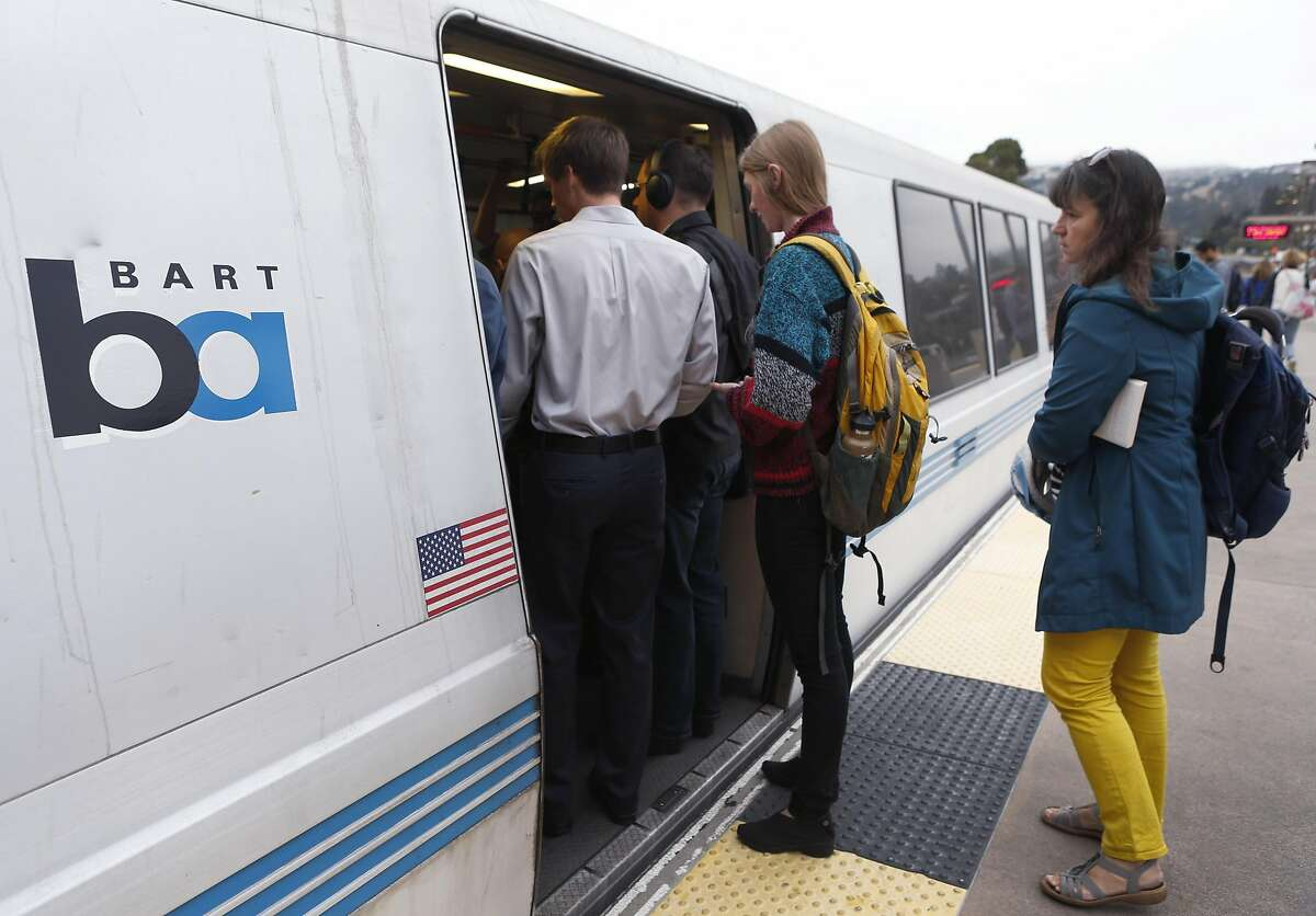 Commuters try to squeeze into a San Francisco-bound train at the Rockridge BART station in Oakland, Calif. on Wednesday, Oct. 12, 2016. BART officials are hoping voters will approve a $3.5 million bond measure to improve the aging infrastructure of the transit system. Scroll ahead to see historical images of construction on BART.