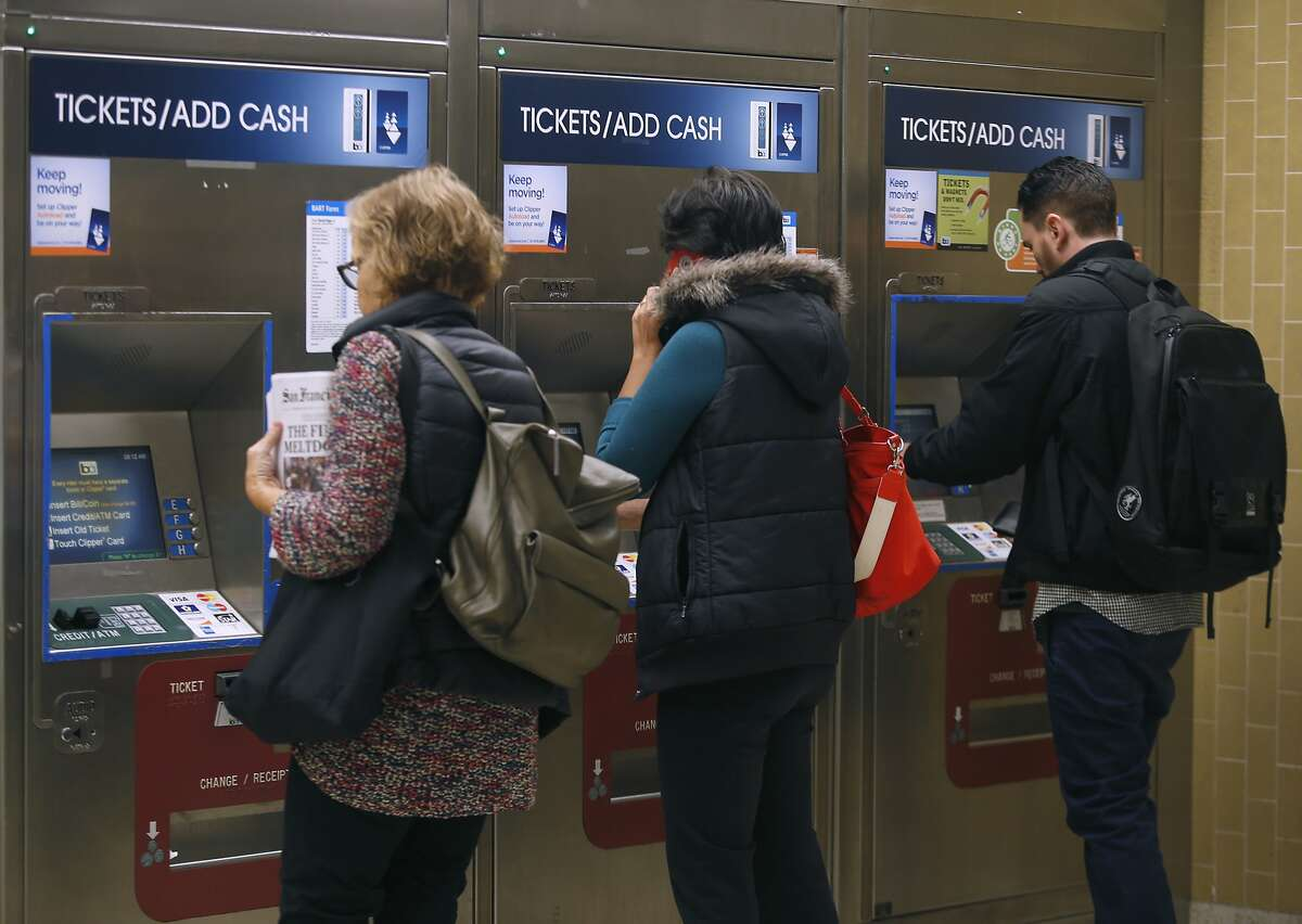 Passengers use the ticket vending machines at the Rockridge BART station in Oakland, Calif. on Wednesday, Oct. 12, 2016. BART officials are hoping voters will approve a $3.5 million bond measure to improve the aging infrastructure of the transit system.