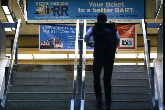 A banner urging passage of a transit bond measure greets passengers entering the Rockridge BART station in Oakland, Calif. on Wednesday, Oct. 12, 2016. BART officials are hoping voters will approve a $3.5 million bond measure to improve the aging infrastructure of the transit system.