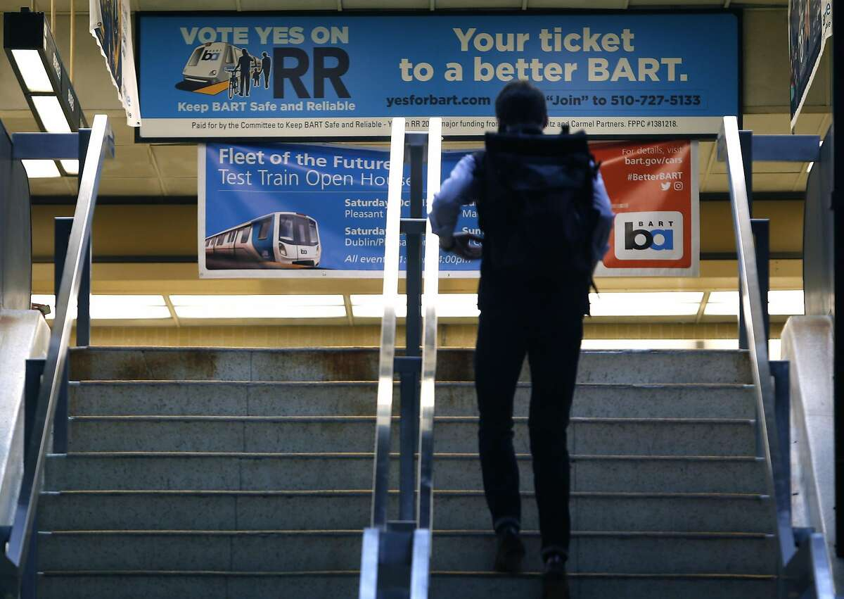 A banner urging passage of a transit bond measure greets passengers entering the Rockridge BART station in Oakland on Wednesday, Oct. 12, 2016. BART officials are hoping voters will approve a $3.5 million bond measure to improve the aging infrastructure of the transit system.