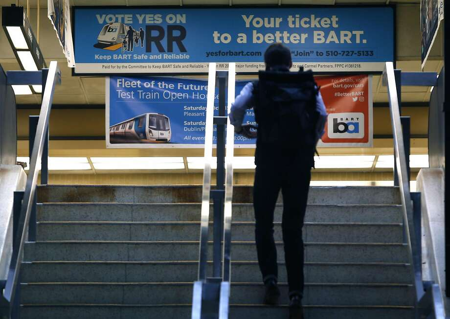 A banner urging passage of a transit bond measure greets passengers entering the Rockridge BART station in Oakland on Wednesday, Oct. 12, 2016. BART officials are hoping voters will approve a $3.5 million bond measure to improve the aging infrastructure of the transit system. Photo: Paul Chinn, The Chronicle