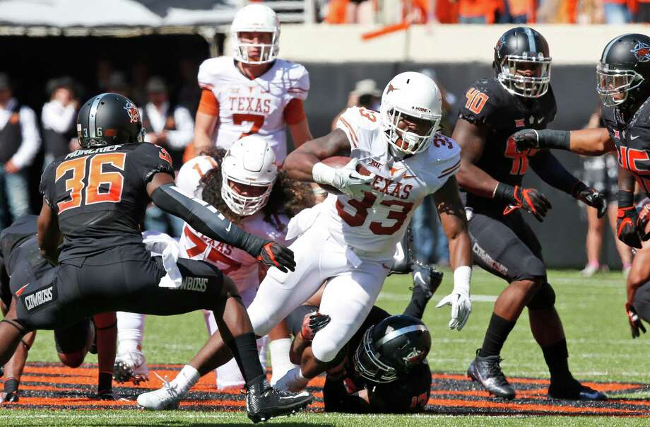 Texas running back D'Onta Foreman (33) carries against Oklahoma State in the first half of an NCAA college football game in Stillwater, Okla., Saturday, Oct. 1, 2016. Oklahoma State won 49-31. (AP Photo/Sue Ogrocki) Photo: Sue Ogrocki, STF / AP2016