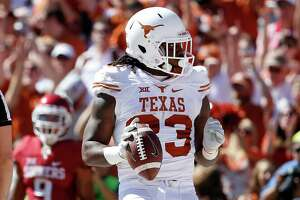 Texas running back D'Onta Foreman (33) celebrates after scoring a touchdown against Oklahoma during the first half in the Red River Showdown at the Cotton Bowl in Dallas on Saturday, Oct. 8, 2016. Oklahoma won, 45-40. (Ron Jenkins/Fort Worth Star-Telegram/TNS)