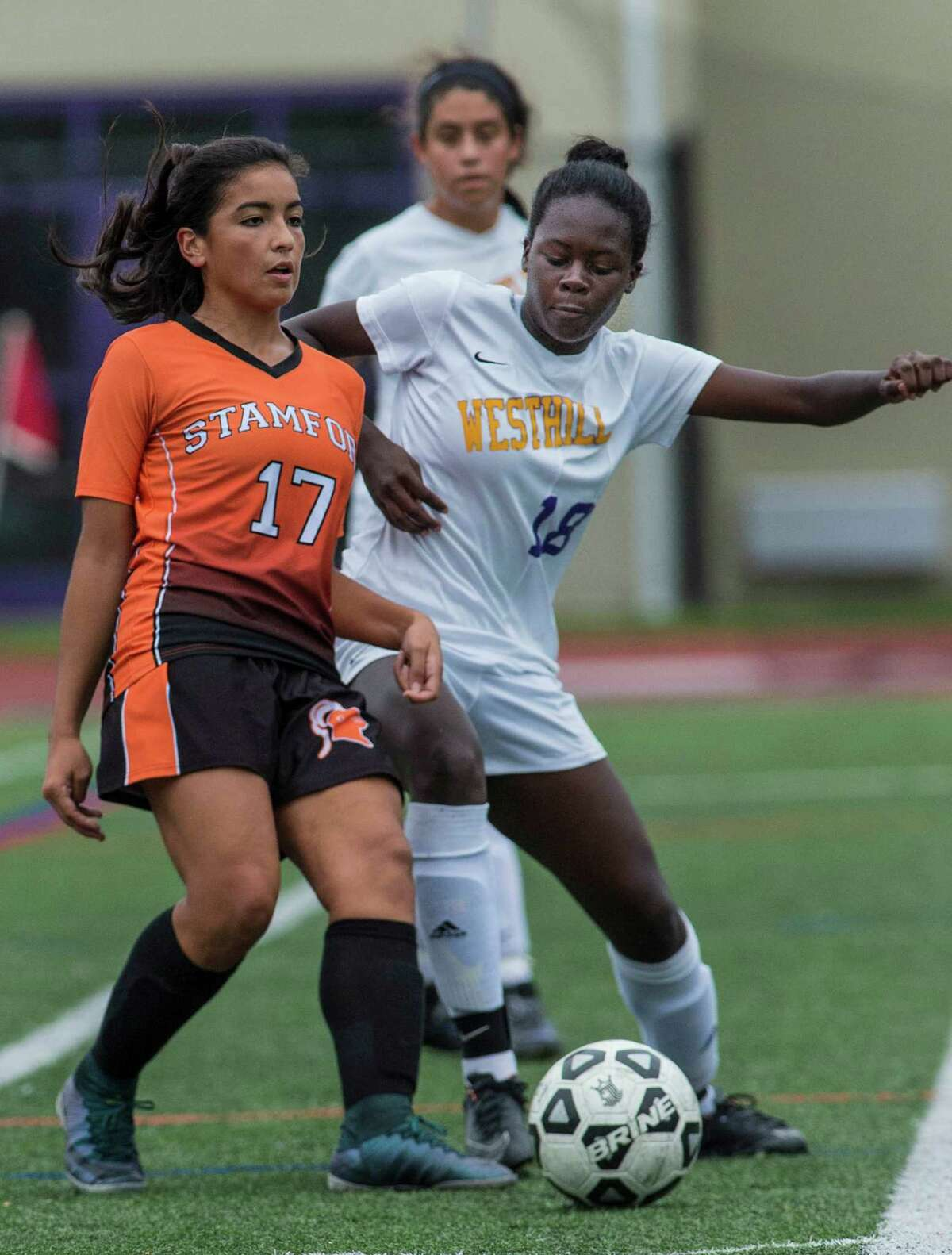 Westhill High School?'s Chelsea Domond battles Stamford High School?'s Fabiano Bueno for the ball during a girls soccer game played at Westhill High School, Stamford, CT. Saturday, October 8, 2016.
