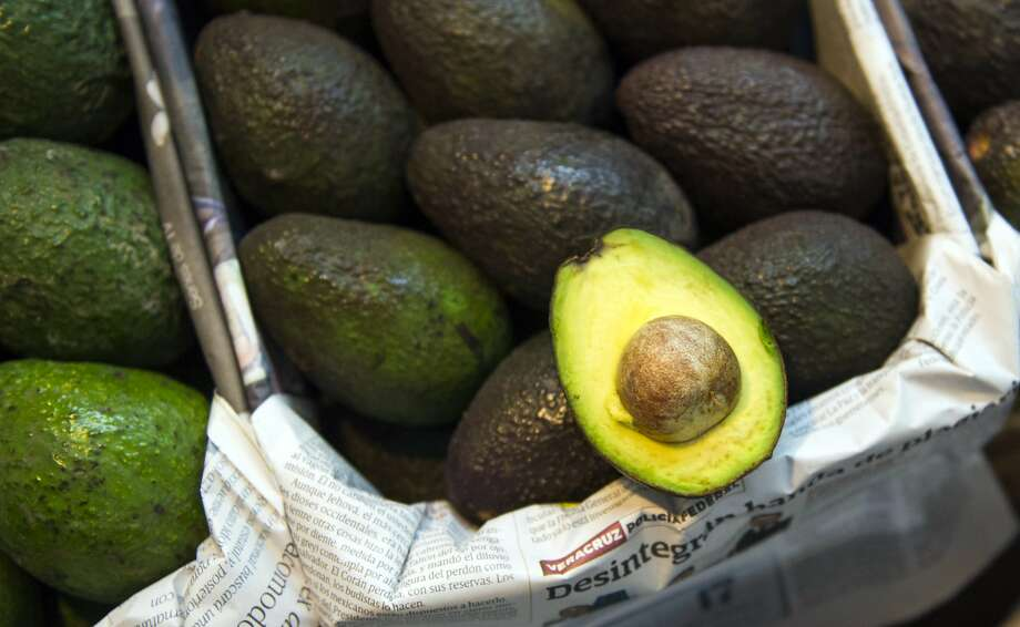 Avocados are displayed for sale in a large market in Mexico City, Tuesday, Aug. 9, 2016. Avocado trees flourish at about the same altitude and climate as the pine and fir forests of Michoacan, the state that produces most of MexicoÕs avocados. That has led farmers to fight a game of cat-and-mouse with authorities, thinning the forests and planting young avocado trees under the canopy. (AP Photo/Nick Wagner) Photo: Nick Wagner, AP