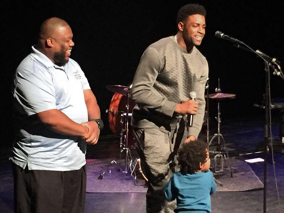 Raiders wide receiver Michael Crabtree (right) was joined by his son, Michael III, and Rodney Baker, executive director of the Crab5 Foundation, at a charity event in Richmond on Monday.