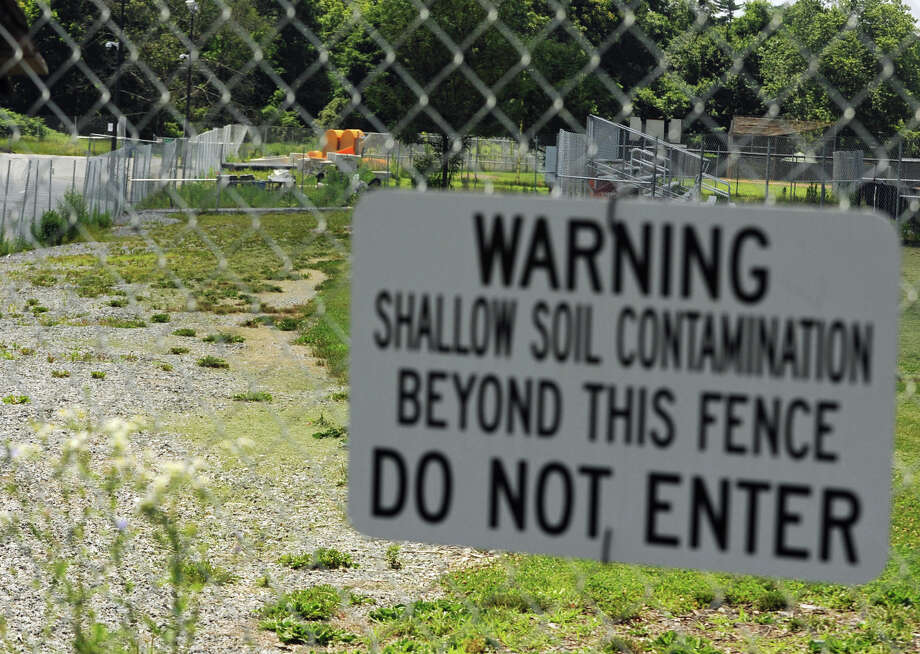 A sign warning of contaminated soil was posted near the entrance to field four behind Greenwich High School on Monday, July 8, 2013. Photo: Jason Rearick / Jason Rearick / Stamford Advocate