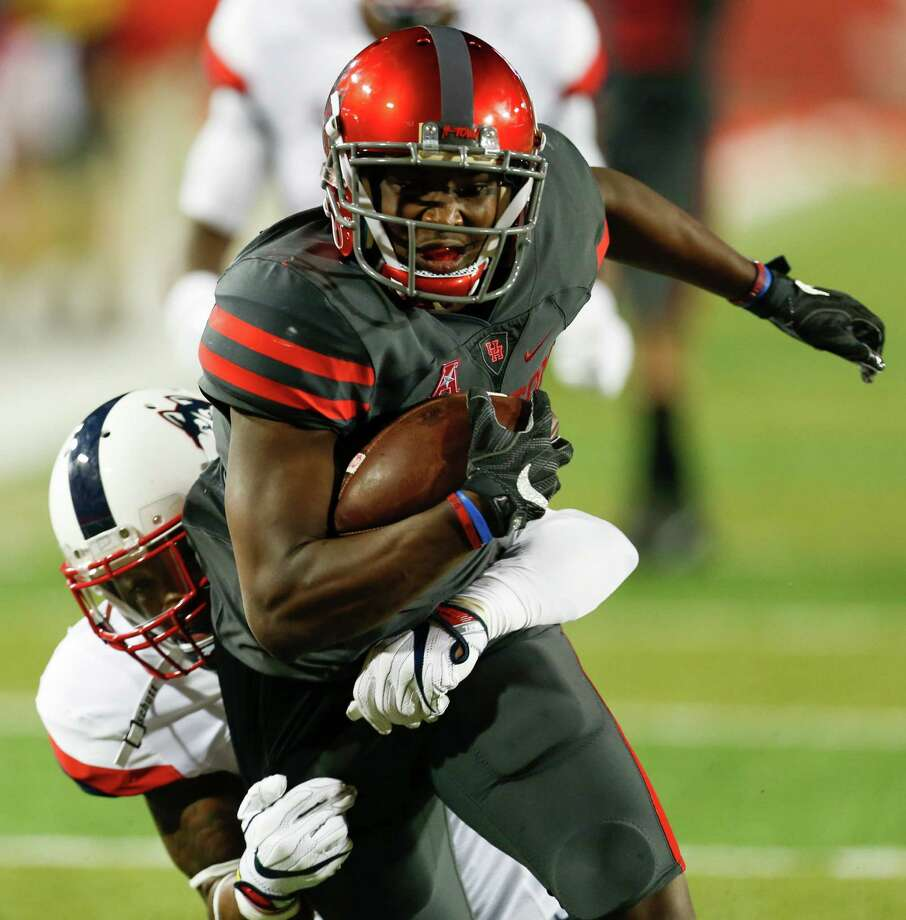 Houston wide receiver Linell Bonner (15) is caught freom behind by Connecticut safety Brice McAllister (16) on a pass reception inside the 10-yard line during the first half of an NCAA football game at TDECU Stadium on Thursday, Sept. 29, 2016, in Houston. ( Brett Coomer / Houston Chronicle ) Photo: Brett Coomer, Staff / © 2016 Houston Chronicle