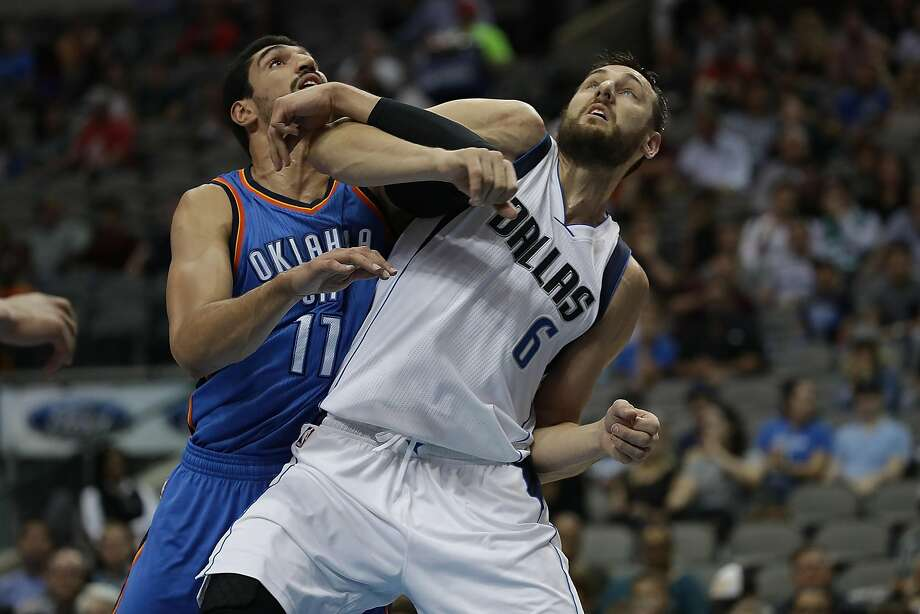 DALLAS, TX - OCTOBER 11:  Enes Kanter #11 of the Oklahoma City Thunder and Andrew Bogut #6 of the Dallas Mavericks battle during a preseason game at American Airlines Center on October 11, 2016 in Dallas, Texas.  (Photo by Ronald Martinez/Getty Images) Photo: Ronald Martinez, Getty Images
