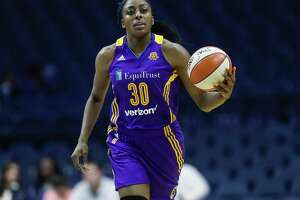 Los Angeles Sparks forward Nneka Ogwumike brings the ball up court against the Chicago Sky during the first half of Game 4 of the WNBA basketball semifinals, Tuesday, Oct. 4, 2016, in Rosemont, Ill. (AP Photo/Kamil Krzaczynski)