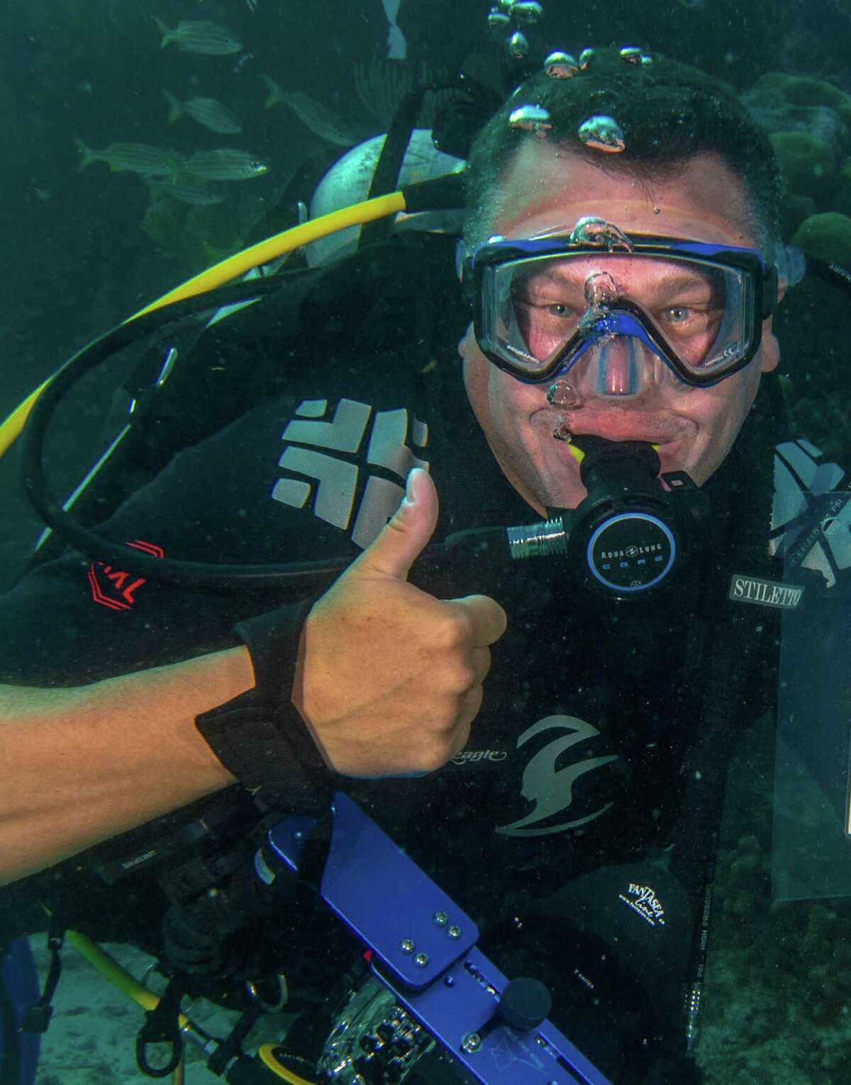 Chris McGee, a sixth-grade math teacher at Nathan Hale Middle School, during a dive off the coast of Mexico. The dive was part of his two-week trip to Grand Cayman and Mexico to study lionfish and learn about conservation.