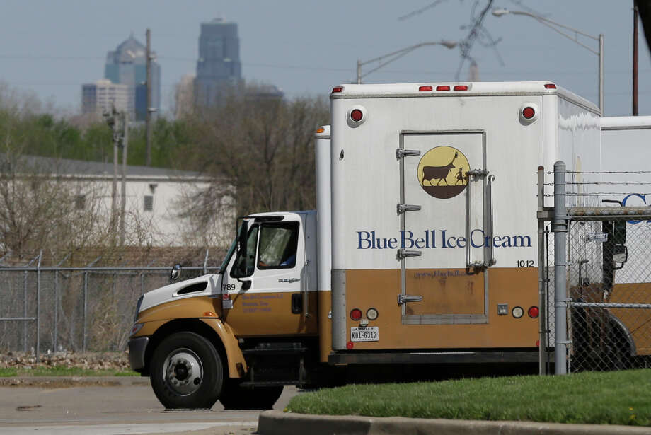 "Blue Bell delivery trucks are parked at the creamery's location in Kansas City, Kan., Friday, April 10, 2015. Days after a foodborne illness was linked to Blue Bell ice cream products, a state inspection of an Oklahoma plant later tied to the infection praised the facility for having no violations and doing a ""great job,"" according to a copy of the inspection report. Tainted Blue Bell ice cream products have sickened eight people — five in Kansas and three in Texas. (AP Photo/Orlin Wagner) Photo: Orlin Wagner, STF / AP"