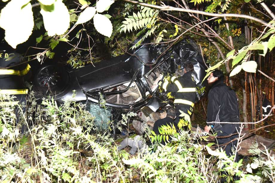 The overturned car at the scene of the crash Wed., Oct. 12, 2016. Photo: Harold F. Cobin