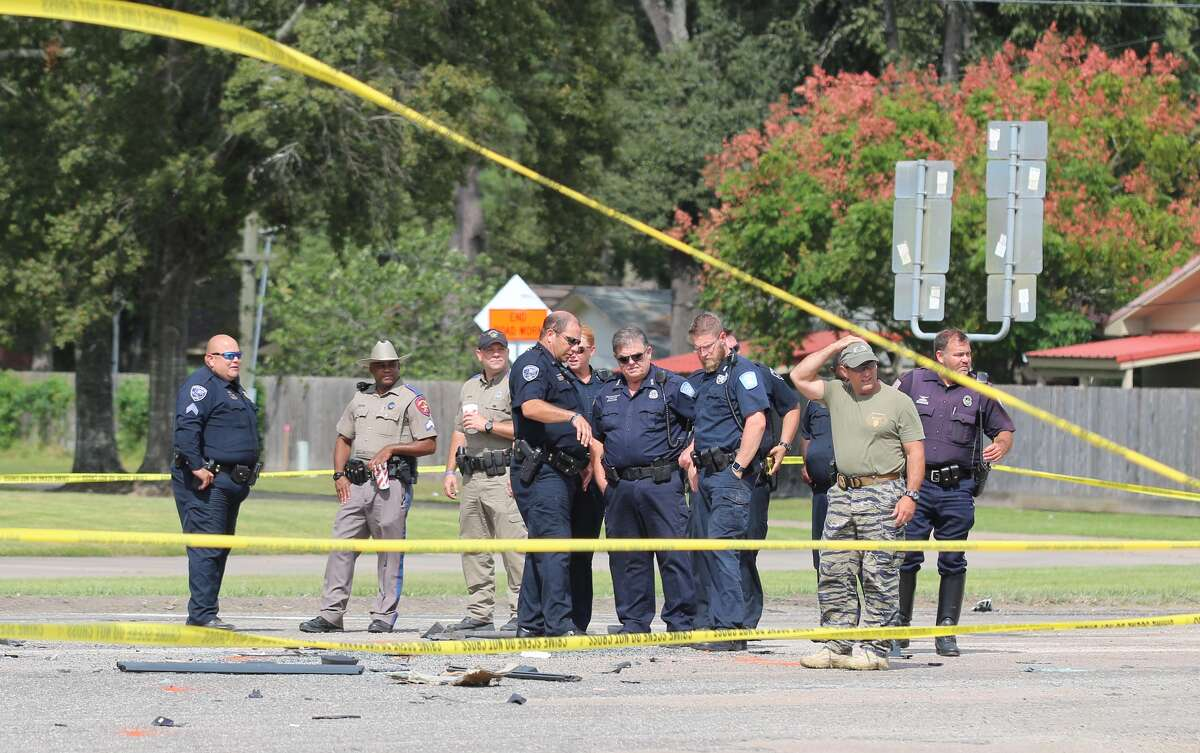 Authorities investigate at the scene of the fatal accident in Liberty on Wednesday.