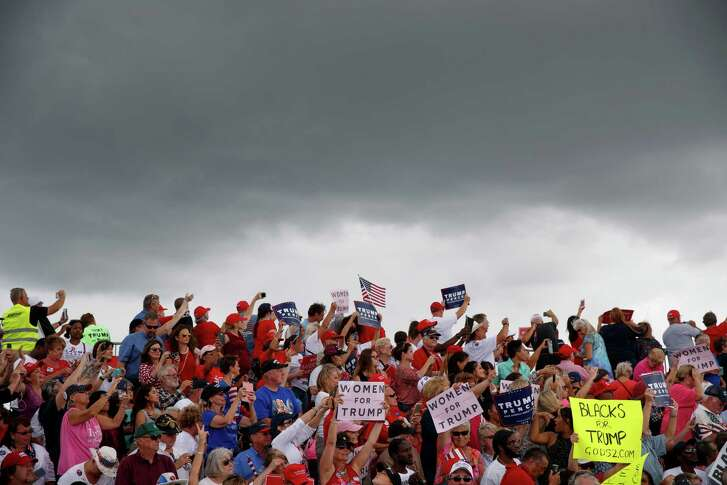 Supporters of Republican presidential candidate Donald Trump cheer during a campaign rally, Wednesday, Oct. 12, 2016, in Lakeland, Fla. (AP Photo/ Evan Vucci)