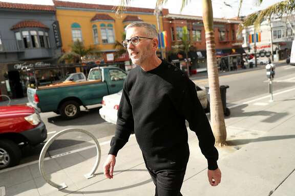 Gerard Koskovich of the GLBT Historical Society walks down Castro Street in San Francisco, Calif., on Wednesday, October 12, 2016.