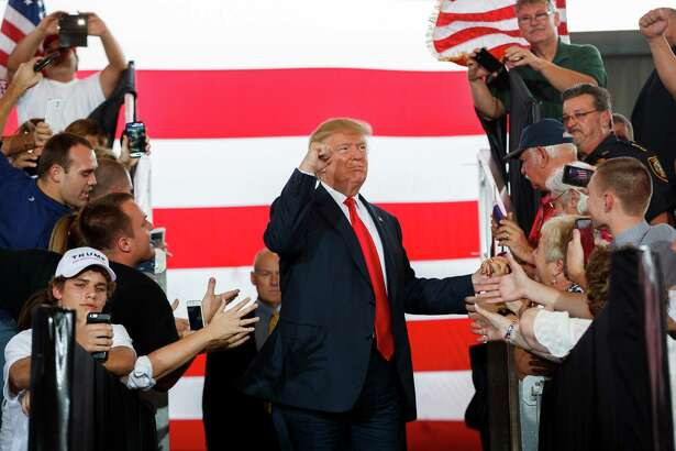 Donald Trump arrives at a campaign rally Wednesday in Ocala, Fla.
