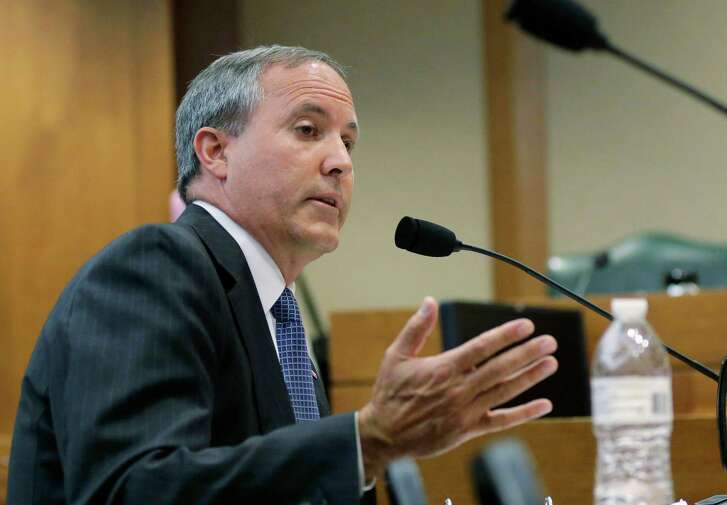 FILE - In this July 29, 2015, file photo, Texas Attorney General Ken Paxton speaks during a hearing in Austin, Texas. Paxton is closer to standing trial on criminal fraud charges after the state's highest appeals court refused to consider dismissing his felony indictments. The decision Wednesday, Oct. 12, 2016, exhausts the Republican's efforts to end the case before trial. Paxton is accused of misleading wealthy investors he personally recruited for a high-tech startup in 2011, four years before becoming Texas' top prosecutor. He has pleaded not guilty to the criminal charges. (AP Photo/Eric Gay, File)