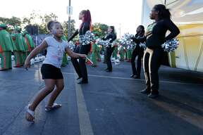 Six-year-old J-unique Stevenson (left) dances alongside members of the Sam Houston High dance team as H-E-B celebrates more than 50 years on the city's Eastside with a Spurs-themed party complete with the Spurs Coyote, Team Energy and the SilverDancers. The Sam Houston High School marching band also joined the celebration filling the late afternoon sky with music as patrons of the store slowly arrived to be treated to food and drink. To top off the event and to show their commitment to the area, H-E-B will be making a $50,000 donation to two organizations in the area, according to an official press release. The event was held at the H-E-B store located at 1012 South W.W. White Road.