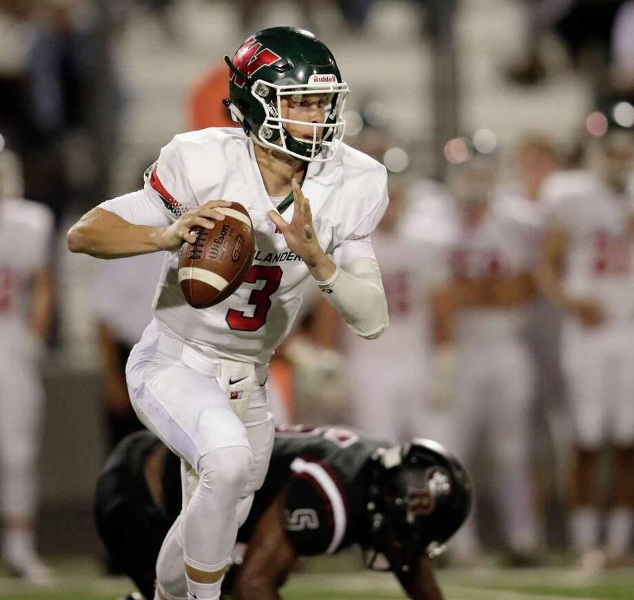 The Woodlands Highlanders quarterback Eric Schmid (3) looks to pass during the high school football game between The Woodlands Highlanders and the George Ranch Longhorns at Traylor Stadium in Rosenberg, TX on Friday, September 16, 2016. Photo: Tim Warner, Freelance / Houston Chronicle