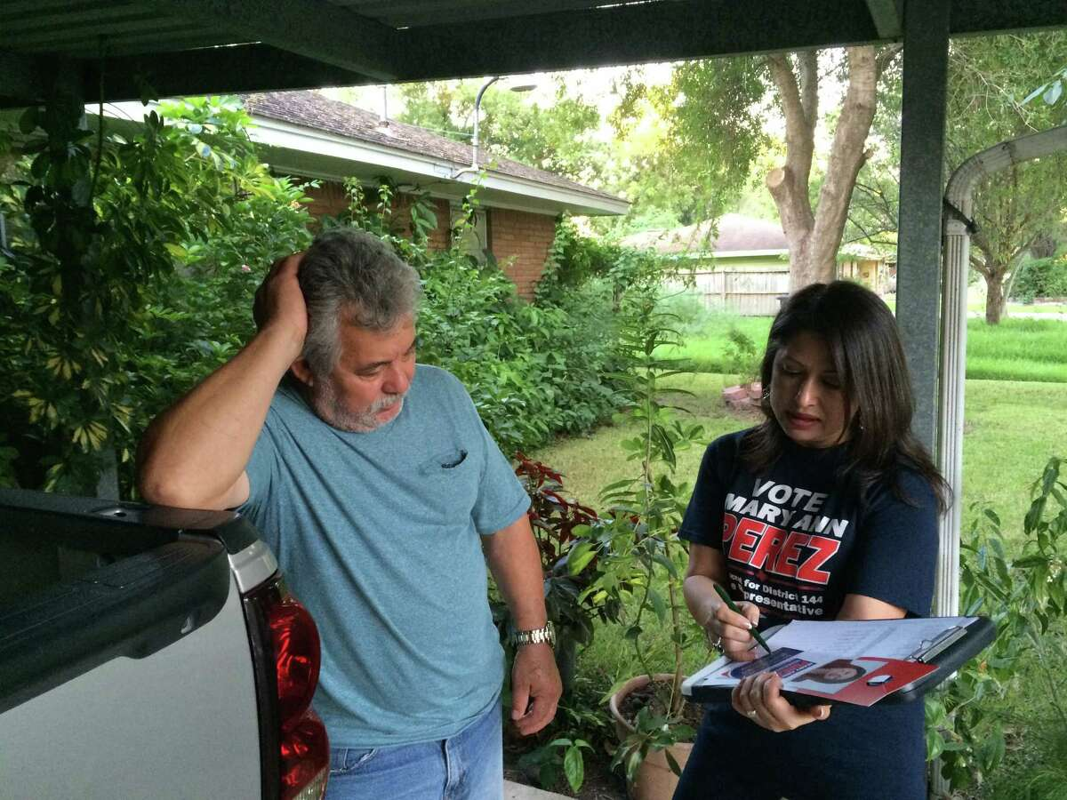 Mary Ann Perez, Democratic candidate for Texas House District 144, talks with voter Felipe Zavala, 65, as she knocks on doors along a residential block in Pasadena, Wednesday, Sept. 28, 2016. Zavala said he is a Republican but will join his Democrat wife and daughter in opposing GOP nominee Donald Trump. Andrew Kragie / Houston Chronicle