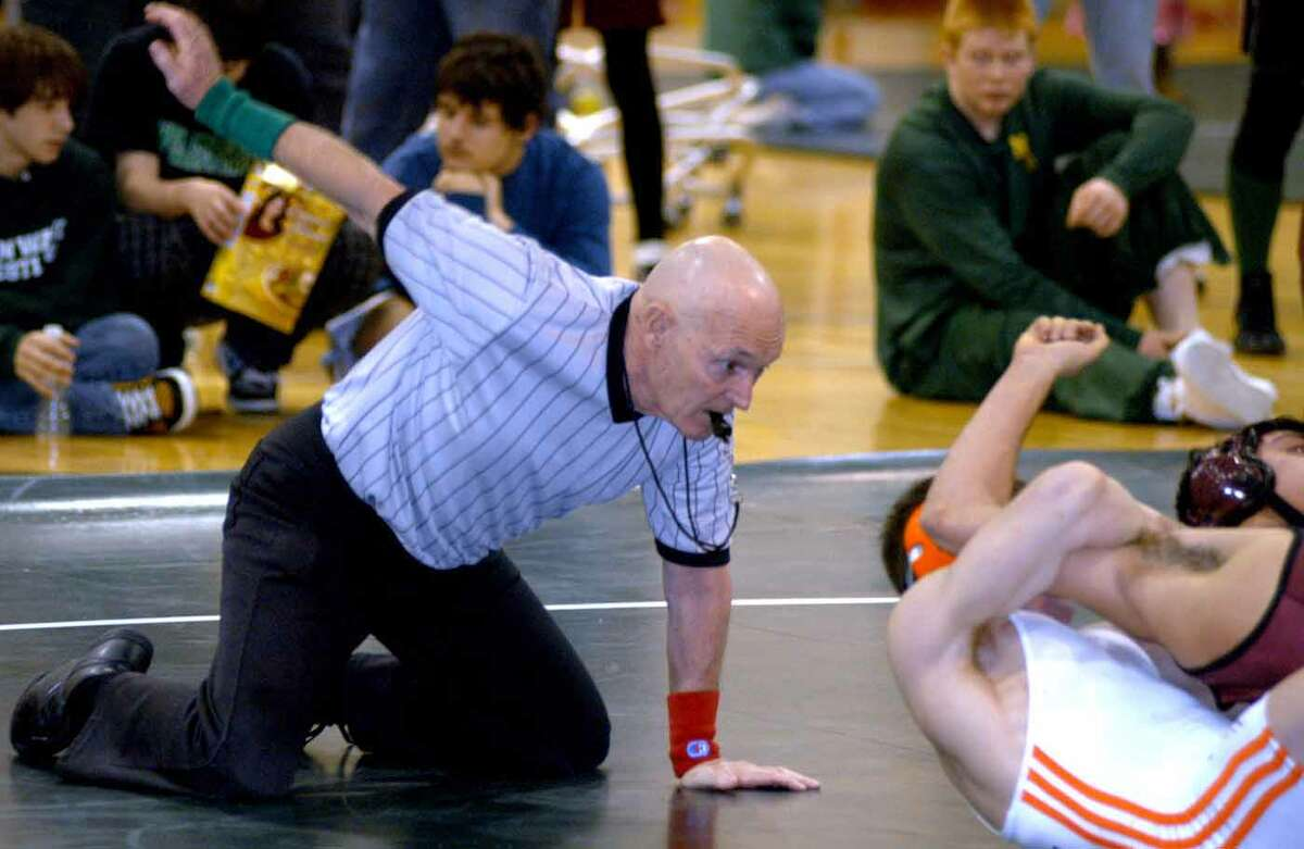 FILE PHOTO: Mike Morris, architect of Danbury High School's wrestling dynasty, referees at the Jan. 19, 2008 New Milford High School wrestling tournament