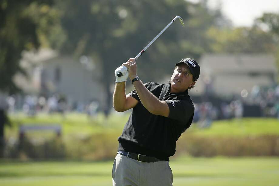 Phil Mickelson follows his approach shot from the first fairway of the Silverado Resort North Course during the pro-am event of the Safeway Open PGA golf tournament Wednesday, Oct. 12, 2016, in Napa, Calif. (AP Photo/Eric Risberg) Photo: Eric Risberg, Associated Press