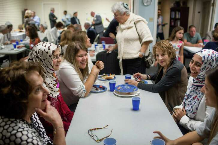 Susan Ghertner (from left), Sacide Atik, Cathy Martinez, Rachelle Neuman, Eda Bozdemir and Busra Ada chat as the followers of Judaism and Islam gathered to break bread.
