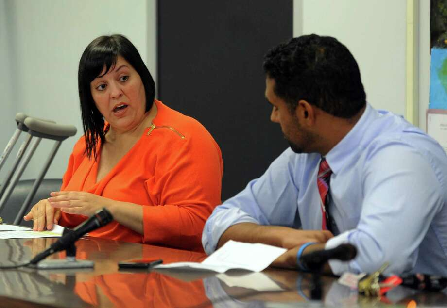 Bridgeport School Board member Maria Pereira, left, talks to Chairman Dennis Bradley during a special meeting at Bridgeport City Hall building in Bridgeport, Conn., on Wednesday Oct. 12, 2016. The full board held the meeting in wake of Tuesday night's illegal meeting with one faction of the board held at Geraldine Johnson School. Photo: Christian Abraham / Hearst Connecticut Media / Connecticut Post