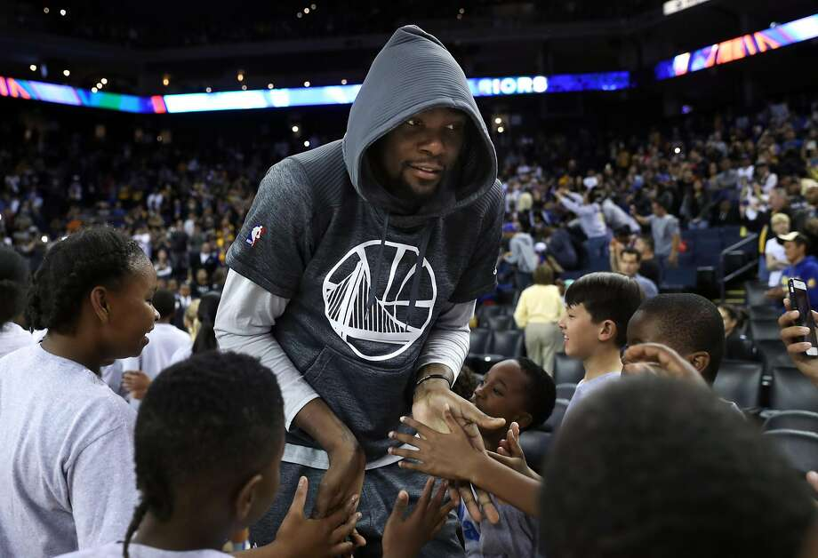 Golden State Warriors' Kevin Durant is introduced during open practice at Oracle Arena in Oakland, Calif., on Wednesday, October 12, 2016. Photo: Scott Strazzante, The Chronicle