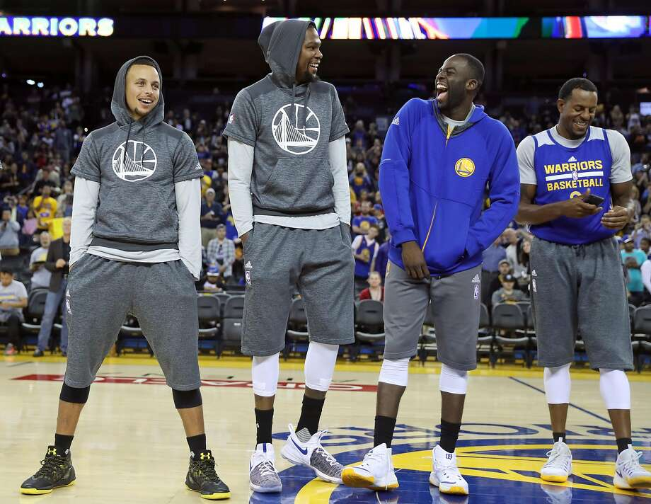 Golden State Warriors' Stephen Curry, Kevin Durant, Draymond Green and Andre Iguodala laugh while bing introduced during open practice at Oracle Arena in Oakland, Calif., on Wednesday, October 12, 2016. Photo: Scott Strazzante, The Chronicle