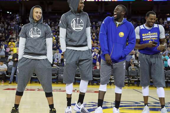 Golden State Warriors' Stephen Curry, Kevin Durant, Draymond Green and Andre Iguodala laugh while bing introduced during open practice at Oracle Arena in Oakland, Calif., on Wednesday, October 12, 2016.