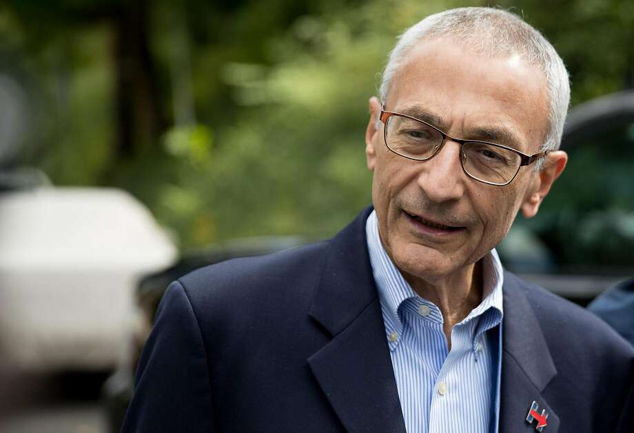 Clinton campaign manager John Podesta speaks to members of the media outside Democratic presidential candidate Hillary Clinton's home in Washington, Wednesday, Oct. 5, 2016. Clinton is at her Washington home today for private meetings. (AP Photo/Andrew Harnik) Photo: Andrew Harnik, Associated Press