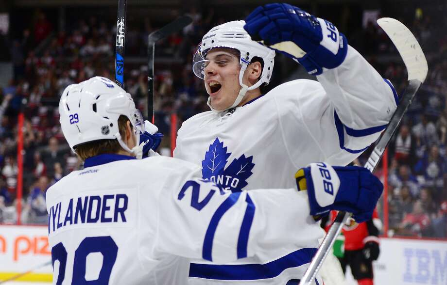 Toronto Maple Leafs center Auston Matthews celebrates a first-period goal against the Ottawa Senators with teammate William Nylander. Photo: Sean Kilpatrick, Associated Press
