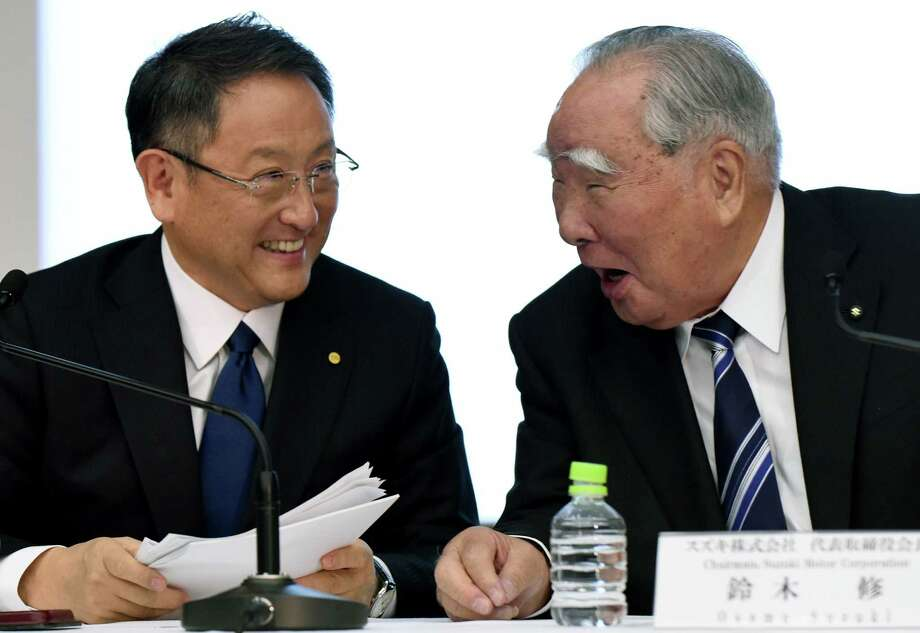 Toyota Motor Corp. President Akio Toyoda, left, and Suzuki Chairman Osamu Suzuki are both members of their companies' founding families. That they held a news conference so early in their partnership talks was unusual. Photo: TORU YAMANAKA, Staff / AFP or licensors
