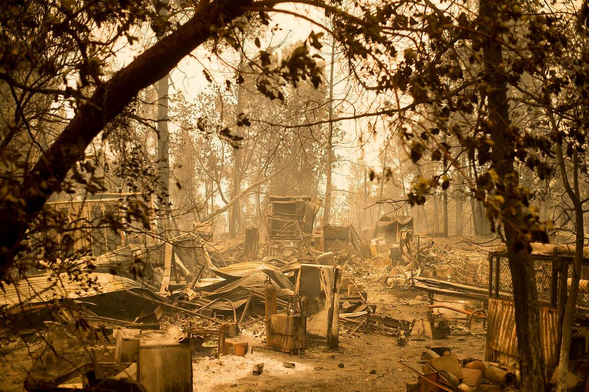 Debris lines a clearing after the Loma fire burned along Loma Chiquita Road near Morgan Hill, Calif., on Wednesday, Sept. 28, 2016. A heat wave stifling drought-stricken California has worsened a wildfire that burned some buildings and forced people from their homes. (AP Photo/Noah Berger)