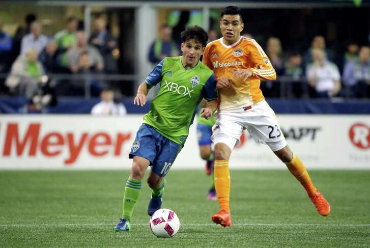 Seattle Sounders midfielder Nicolas Lodeiro, left, is challenged by Houston Dynamo midfielder Jose Escalante, right,  during the second half of an MLS soccer match, Wednesday, Oct. 12, 2016, in Seattle. The match ended in a 0-0 tie. (AP Photo/Ted S. Warren)
