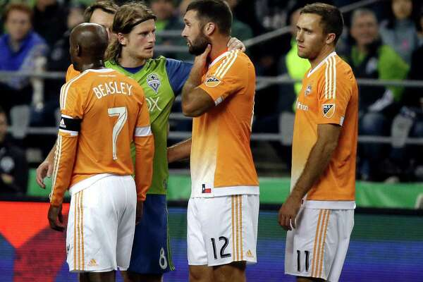 Seattle Sounders' Erik Friberg, second from left, talks with Houston Dynamo's Will Bruin (12), after Bruin was involved in an altercation with Sounders' Osvaldo Alonso, not seen, that resulted in a red card for Alonso during the second half of an MLS soccer match, Wednesday, Oct. 12, 2016, in Seattle. The match ended in a 0-0 tie. (AP Photo/Ted S. Warren)