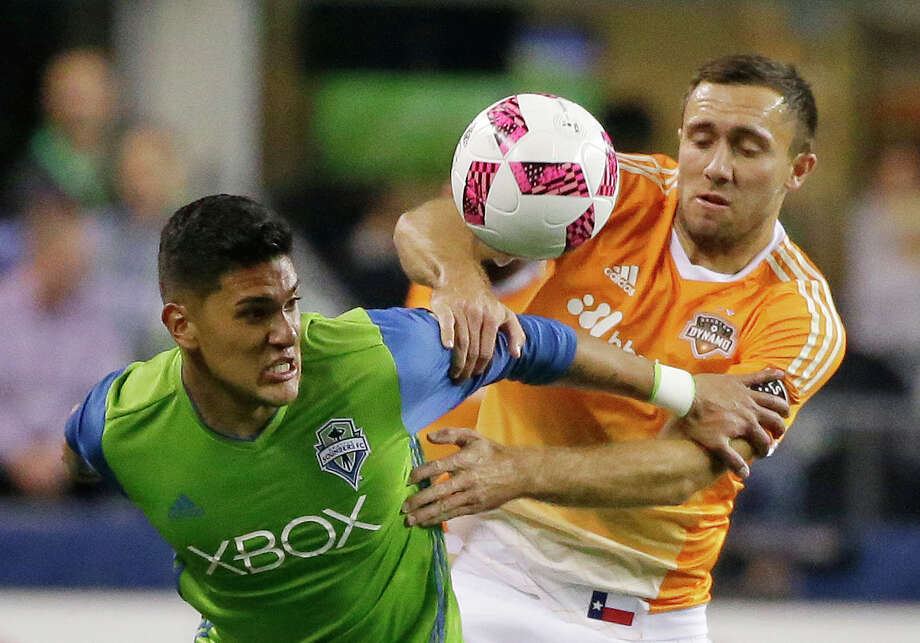 Seattle Sounders' Tony Alfaro, left, and Houston Dynamo's Andrew Wenger, right, battle for a loose ball in the first half of an MLS soccer match, Wednesday, Oct. 12, 2016, in Seattle. (AP Photo/Ted S. Warren) Photo: Ted S. Warren, Associated Press / Copyright 2016 The Associated Press. All rights reserved.