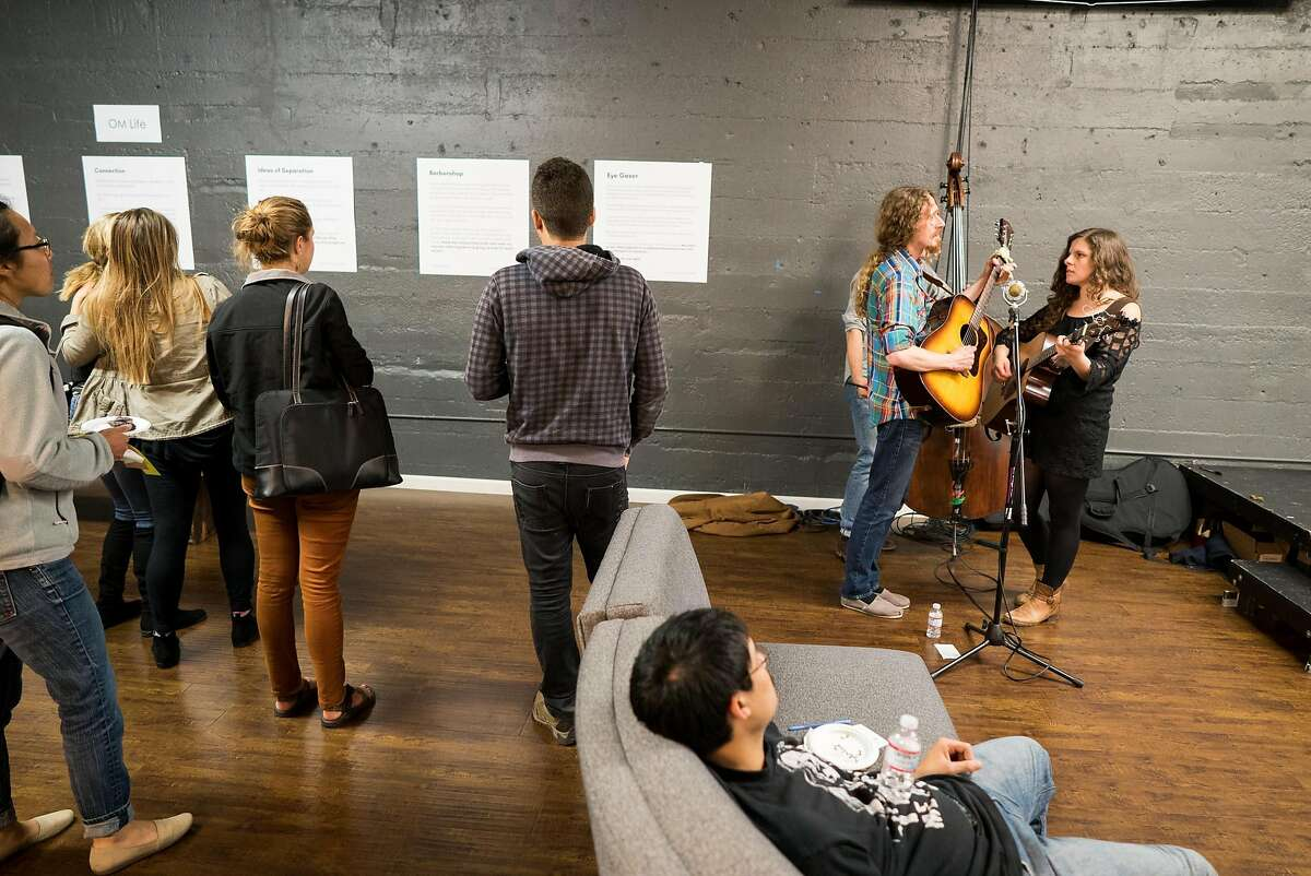 People look at blocks of text featuring awkward exchanges at OneTaste in San Francisco, Calif. on Wednesday, Oct. 12, 2016. The Museum of Awkward featured confessions, text exchanges and stories as a way to talk about intimacy.