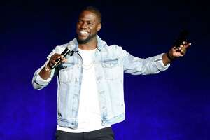 """FILE - In this April 13, 2016 file photo, Kevin Hart, star of the upcoming film """"What Now?,"""" addresses the audience during the Universal Pictures presentation at CinemaCon 2016 in Las Vegas. Hart has signed a deal with Motown Records to release an album under his rapper alter-ego, Chocolate Droppa, this fall. (Photo by Chris Pizzello/Invision/AP, File)"""