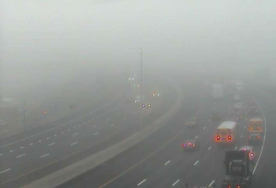 Thick fog blankets I-95 on Thursday, Oct. 12, 2016 near Exit 27 in Bridgeport. Photo: /